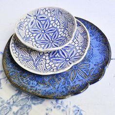 from lee wolf pottery Love the periwinkle blue on the bottom plate