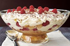 Layers of sponge fingers, fruit and fresh ricotta are doused in cream and chocolate to create this decadent dessert.