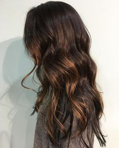 dark brown hair with subtle medium brown balayage