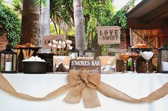 A create-your-own-s'mores bar is a crowd-pleasing option any time of year.Related: 75 Ideas for a Rustic Wedding