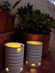 save your old cans and make candle holders. I would have chosen to spray paint gold or turquoise but that's just me!