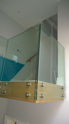 Frameless design patch fixing glass landing balustrade system. Toughened and laminated clear glass.