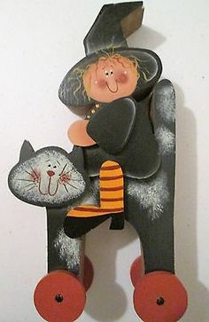 Halloween-Decoration-Witch-Riding-On-a-Cat-With-Wheels-Black-Orange