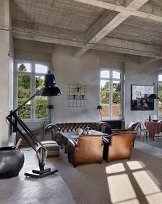 concrete floor | textured ceiling | chesterfield | large floor lamp