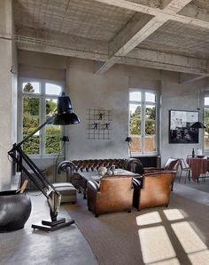 concrete floor | textured ceiling | chesterfield | large floor lamp