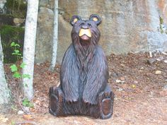 Black Bear Carved Out Of A Tree