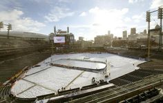 A fresh dusting of snow covered Comerica Park on Tuesday, Dec. 31, 2013, before the start of the Alumni Showdown between the Detroit Red Wings and Toronto Maple Leafs in Detroit.