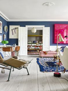 livingroom with colorful art, beautiful carpets and delightful lightning