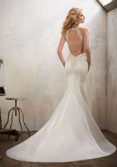Mixing a bit of fairytale with modern style, these Morilee wedding dresses have the most stunning open back details we've ever seen!