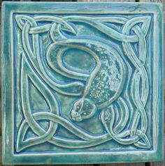 Decorative relief carved ceramic Celtic seal by earthsongtiles Azulejos Art Nouveau, Art Nouveau Tiles, Art Deco, Celtic Art, Celtic Dragon, Shadow Art, Handmade Tiles, Celtic Designs, Decorative Tile