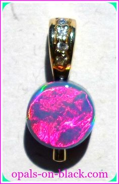 A stunning solitaire Gem Opal doublet pendant & diamond encrusted solid 9 carat yellow gold bail.  This is a gorgeous pendant, the opal is very high quality Crystal from Lightning Ridge, Australia.