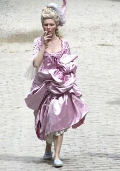 MARIE ANTOINETTE - Kirsten Dunst strolls to the next scene while smoking a cigarette - Directed by Sofia Coppola - Columbia Pictures. Sofia Coppola, Marie Antoinette Film, Kirsten Dunst Marie Antoinette, Marie Antoinette Costume, Glamour, Movie Costumes, Looks Cool, Costume Design, Divas