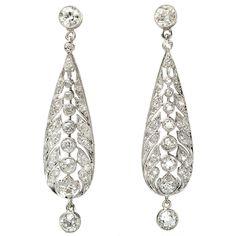 Diamond Platinum Drop Earrings c1910. Platinum; Old European Cut Diamonds; Old Single Cut Diamonds. Mille Grain Platinum Work.