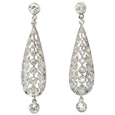 Diamond Platinum Drop Earrings c1910. Platinum; Old European Cut Diamonds; Old Single Cut Diamonds. Mille Grain Platinum Work.