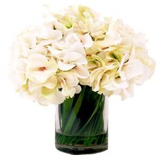 Create a lush tablescape or accent your sideboard in chic style with this lovely arrangement, showcasing faux white hydrangea in a simple round vase.