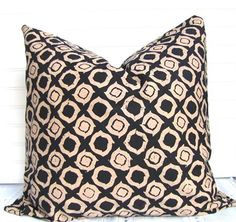 Striking black and tan batik fabric decorative pillow cover, 20 x 20 inch. Premium quilting cotton batik. Pictured on a feather pillow insert. For a puffier look, use a fiberfill insert. This pillow has the same fabric front and back, with a generous envelope-style opening for easy removal.   Here are the details:   *Best fit is 20 x 20 insert  *Hand-washable  *Smoke-free studio  *Corners are slightly rounded for professional fit and appearance.  *All seams are reinforced, overlocked or…