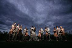 dramatic wedding party photo dark stormy sky peach pink tan Matt Shumate Photography at Arbor Crest Winery