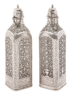 Pair of Persian Silver Covered Glass Decanters : Lot 107. Hammer Price- $1,800