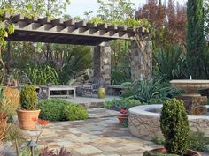 Mediterranean Oasis  This outdoor space mixes formal details you might see in an Old World garden with modern, casual touches. Designer Molly Wood placed a Spanish-inspired central fountain in the heart of the space, while the vine-covered pergola provides ample shade.