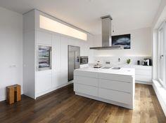 Modern Style White Kitchen Island Inpiration Design With Led Lighting On The Wall Above Backsplash Including Hardwood Flooring Ideas Inspirational Kitchen Island Design; Planning Before Applying Kitchen design