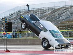 Whenever I talk to import lovers about drag racing and they start bashing on American cars I show a picture such as this one with a car wheel standing and actually lifting off the ground completely. When a Honda Civic can do that then maybe I'll listen to their argument.