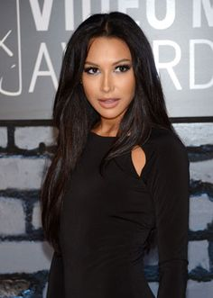 Actress Naya Rivera appeared on the Red Carpet at the 2013 MTV Video Music Awards (VMA) in a slinky black gown off set by her raven tresses.