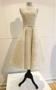 "Audrey Hepburn wore this dress to receive her first Oscar in 1954 , belted ivory lace gown by Edith Head (who also won an Oscar for costume design)  Audrey wore the dress with a matching hat and jacket for her final scene in 'Roman Holiday', before adapting it to wear to the Oscars. From then on, she referred to it as her ""lucky dress""."