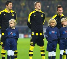 Lewandowski, Reus, and Götze.  Lewandowski's expression is the best!