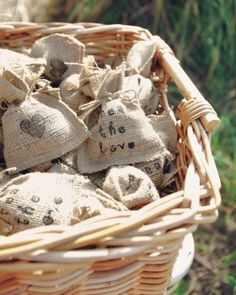 "BURLAP CONFETTI TOSS Guests were given ""Spread the Love"" burlap sachets filled with black sunflower seeds to toss at the night's end. The r..."