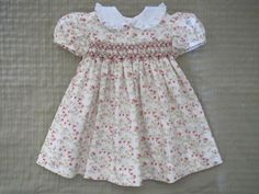 He encontrado este interesante anuncio de Etsy en https://www.etsy.com/es/listing/232918976/baby-girls-classic-hand-smocked-dress