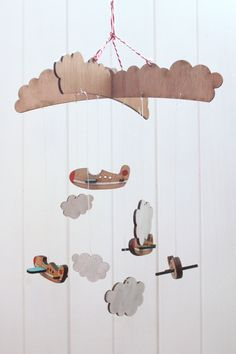 Aeroplane Baby Mobile. $100.00, via Etsy. (I might make this out of cardboard...)