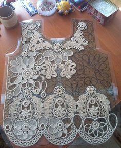 Crochet cord lace with Irish crochet motifs and needle-weaving: