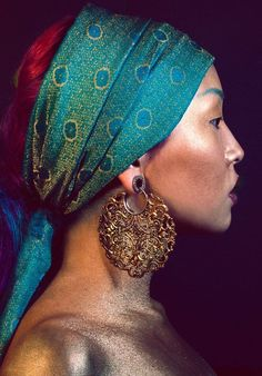 Model wearing a Turqouise-Teal Bandana with Gold Accents