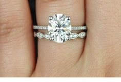 OVAL diamond solitare with platinum micropave setting. Love the delicate vintage band too.