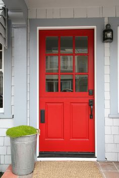 Red dutch door + shakes + potted moss