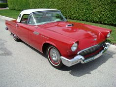 57 T-bird - another one of my early memories... again around the age of 3 1/2 was looking at a T-bird like this with my brother... I can clearly remember sitting in it and looking out of the porthole window in the hardtop... the deal fell thru and he didn't get the car... ended up buying an Austin Healy 3000 instead.  I don't there has ever been, nor will there ever be a car as beautiful as this year's T-Bird.