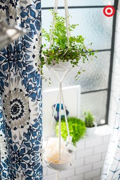 So boho. Hanging plant holders in the bathroom is such a fun way to breathe a little life into your space.