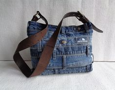 One of a kind handmade denim purse. Very unusual and stylish handbag for your casual look! 100% recycled materials.