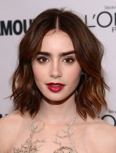 Lily Collins' berry lip and vampy eyeshadow is perfect for  holiday cocktails (love the hair)
