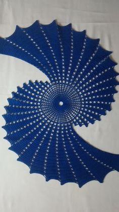 Fractal crochet centerpiece, doily makes a unique statement.