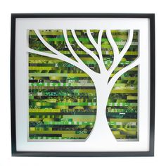 """Tree Shadowbox (by Amy Gibson) - intricately hand-cut tree against a forest-colored collage of discarded pages. Shadowbox is 20.5"""" x 20.5"""", frame is .75"""" thick and 1.75"""" deep."""