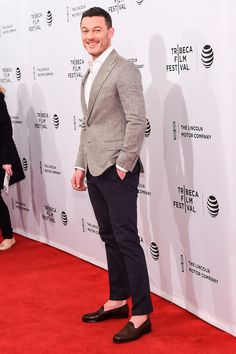 20 April Luke Evans paired a grey blazer with navy trousers for the premiere.   - HarpersBAZAAR.co.uk