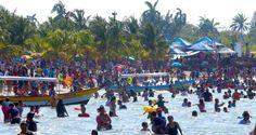 Honduras: 50,000 turistas colman las bellas playas de Tela  Los veranenantes disfrutaron a lo grande de su último sábado de Semana Santa en las bellas playas de la ciudad. La ocupación hotelera superó el 95%, según Turismo. La diversión en Tela y la Ceiba fue absoluta. Muchos disfrutaron del agua cálida y otros bailaron o viajaron en lachas. Fotos: Yoseph Amaya