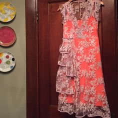 Nanette Lepore Waldorf Dress Saddest re-posh ever. Size 0 Nanette Lepore for Beegdorf Goodman. Neon orange bodice and lavender lace top. This is the BG exclusive version of the beloved Waldorf Sheath, featuring a fuller skirt and a waterfall waist detail. The dress does run big, and the previous seller wore it as a size 6. I'm a 32d and can't seem to get the last few inches of zipper up. I think it could work well for a 0, 2, 4 or smaller 6. Nanette Lepore Dresses