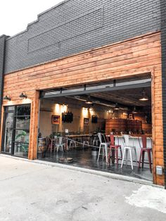 Industrial taproom and coffee shop with awesome garage door feature. Brewery Decor, Brewery Design, Restaurant Design, Pub Decor, Modern Restaurant, Industrial Coffee Shop, Industrial Cafe, Cafe Exterior, Building Exterior