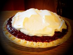 """Raspberrry Cream Pie- # 1 Seller   Boil 3/4 c. water and 1/2 c. sugar. Mix together 1 T. cornstarch, 1 c. water, pinch salt, & 1/4 t. lemon juice; add water & sugar mixture, boil until clear. Add 3 oz. pkg. raspberry jell-o  until dissolved. Cool mixture & add 2 c. fresh raspberries. In a 9"""" pie crust, put 2 c. of cooled vanilla pie filling. Place 1 c. of the raspberry pudding on top of pie filling. Top with whipped cream. Makes 2 pies. #raspberrypie #pie #bakery #sweettreat"""