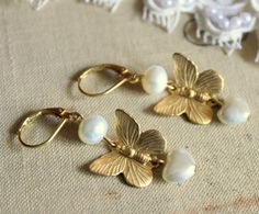 """Vintage butterfly Earrings dangle Victorian shabby chic vintage style with real fresh water pearls. Elegant chic earrings ,1.5"""" long. The earrings made of brass with real freshwater pearls dangle from them and vintage acrylic pearl heart drop made in Japan. They measure 10mm high . The earring hocks are vintage brass lever-back. Pearls jewelry is Elegant And Sophisticated , for your wedding day ,special occasions , or just for fun !"""