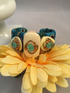 Ribbon Cuff Bracelet, teal cuff, blue and yellow bracelet, repurposed jewelry, reclaimed earrings, vintage cuff, wrist wrap, eco friendly by Generations2Sisters on Etsy https://www.etsy.com/listing/239466315/ribbon-cuff-bracelet-teal-cuff-blue-and