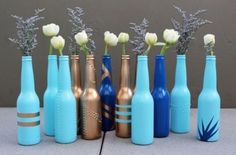 Make cool DIY projects with beer bottles: They are the craft supply that just keeps on giving! Get into upcycling and make awesome beer bottle crafts for your home. From beer bottle glasses to ligh… Beer Bottle Glasses, Bottle Vase, Bottles And Jars, Glass Bottles, Beer Bottles, Painted Bottles, Painted Vases, Soda Bottles, Empty Bottles