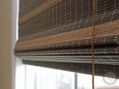 Woven Shades with natural striping installed in a client's game room.